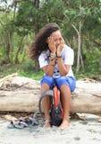 Shaming girl hiding behind hands Royalty Free Stock Photo
