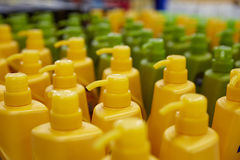 Shampoo array. Colorful shampoo bottles in array royalty free stock images