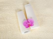 Shampoo, balm and orchid flower Royalty Free Stock Image