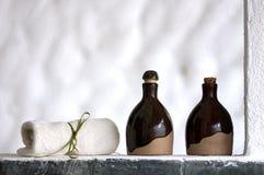 Shampoo, body lotion and towel Royalty Free Stock Photography