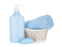Shampoo bottle, soap and blue towel Royalty Free Stock Image