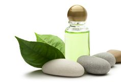 Shampoo bottle with stones Stock Images