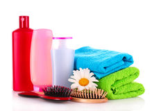 Shampoo bottles and hair brush Stock Photography