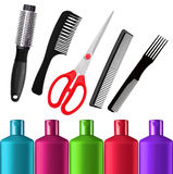 Shampoo bottles, red scissors and combs isolated on white Royalty Free Stock Image
