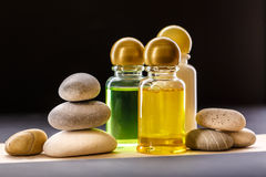 Shampoo bottles with stones Royalty Free Stock Photography