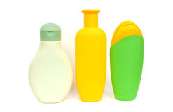 Shampoo bottles on white background. Three coloured shampoo bottles isolated on white Royalty Free Stock Photos
