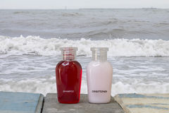 Shampoo and conditioner with sea on the beach. Royalty Free Stock Image