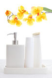 Shampoo, conditioner and soap with flowers Stock Photo