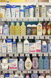 Shampoo and cosmetic products on shelves Stock Photos