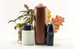 Shampoo, deodorant, lotion, perfume was taken in white background. Leaves in the background cosmetic packaging cream care isolated skin bottle spray gel liquid royalty free stock images