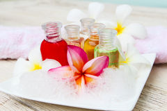 Shampoo and gel bath. Shampoo and gel bottles with towels and flower.  on white background Stock Photos