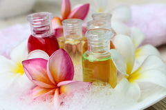 Shampoo and gel bath. Shampoo and gel bottles with towels and flower.  on white background Royalty Free Stock Photo