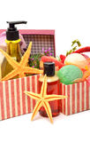 Shampoo, gel bottles, bath bomnbs with starfishes in gift boxes Royalty Free Stock Images