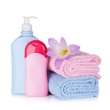 Shampoo and gel bottles with towels and flower Stock Photos