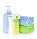 Shampoo and gel bottles with towels and flower Stock Photo