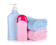 Shampoo and gel bottles with towels Royalty Free Stock Photo