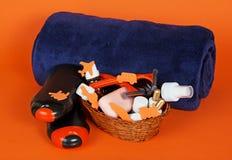 Shampoo, gel, cosmetics in basket Royalty Free Stock Photo