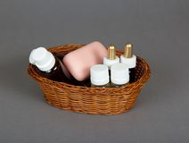 Shampoo, gel, soap in basket for hotel Stock Photography