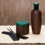 Shampoo and hair mask with combs. Hair care cosmetics. Shampoo and hair mask with combs. Copy space Royalty Free Stock Photos