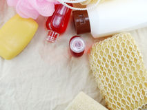Shampoo and liquid shower gel with bath puff and loofah spa kit top view Stock Photos
