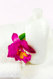 Bottle, orchid & towels Stock Image