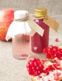 Shampoo with pomegranate oil Stock Image