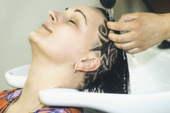 Shampoo in salon woman Royalty Free Stock Image