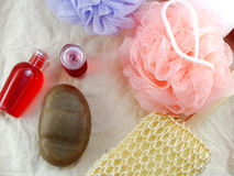Shampoo and shower gel with bath puff and loofah spa kit top view Royalty Free Stock Photo