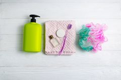 Shampoo or shower gel green bottle with towel washcloth and bath accessories stock photo
