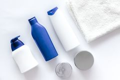 Shampoo and shower gel for men on white background top view Stock Image