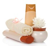 Shampoo, terry towel and a face cream Stock Photos