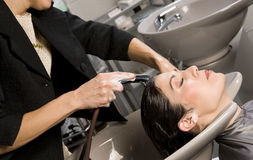 Shampoo Time Hair Rinsed in Professional Salon Stock Photo