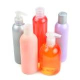 Shampooflessen en zeepautomaten Stock Foto