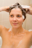 Shampooing hair Stock Image