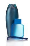 Shampooing, lotion après le rasage et le rasoir de sécurité Photographie stock