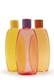 Shampoos. 3 multi-colored shampoos on a white background (isolated royalty free stock photos