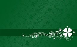 Shamrock Background. Green horizontal background with shamrock and swirls ideal for St. Patrick's Day Stock Images