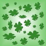Shamrock Background Design Template. Shamrock illustrations on a varigated green background royalty free stock photo