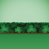 Shamrock Clover Field Background. A saint patrick's day themed background with a patch or field of three and four leaf clovers / shamrocks Stock Photos