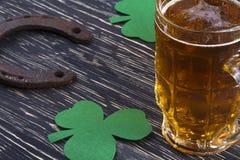 Shamrock clover, horseshoe, beer -symbol of St Patrick's Day Stock Images