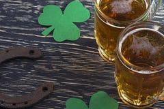 Shamrock clover, horseshoe, beer -symbol of St Patrick's Day Royalty Free Stock Photos