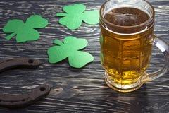 Shamrock clover, horseshoe, beer -symbol of St Patrick's Day Stock Photos