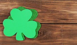 Shamrock. Clover leaves on wood background. St. Patrick's Day Stock Image