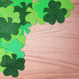 Shamrock Corner Border over wood background. St. Patrick's Day. Royalty Free Stock Photo