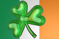 A shamrock displayed against an Irish flag Royalty Free Stock Photos