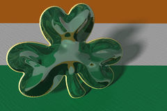 A shamrock displayed against an Irish flag Stock Photography