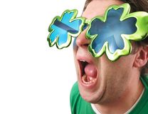 Shamrock Glasses Man. A man wearing shamrock glasses on St. Patrick`s Day Royalty Free Stock Photography