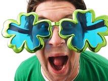 Shamrock Glasses Man. A man wearing shamrock glasses on St. Patrick`s Day Royalty Free Stock Photo