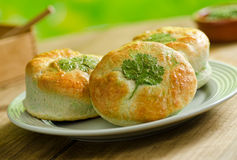 Shamrock Green Biscuits. St. Patrick's Day biscuits with green butter and parsley garnish Stock Image