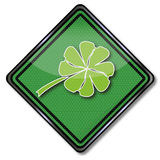Shamrock and happiness. Green shield with shamrock and happiness Stock Images